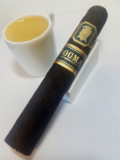 Drew Estate Dogma Undercrown cigar next to espresso coffee